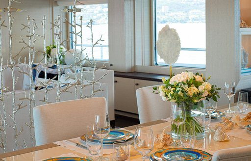 details on luxury yacht spirit, table setting and silver sculpture