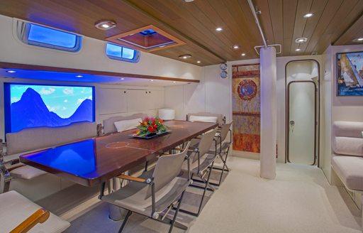 eight-seater dining table aboard luxury yacht JUPITER