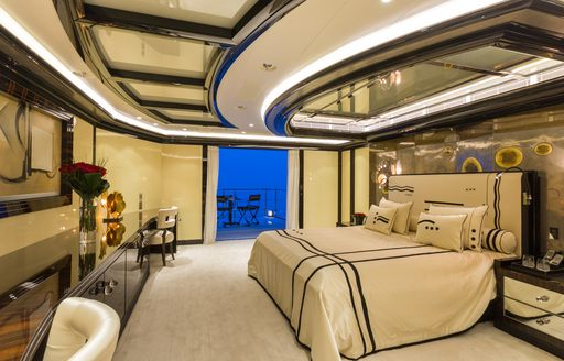 The master suite and retractable balcony on motor yacht OKTO