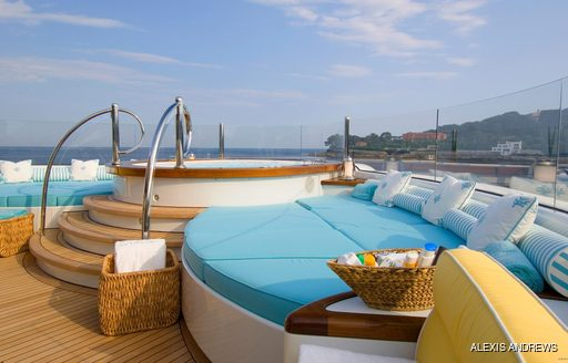 Jacuzzi and sun pads on board OASIS
