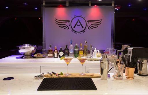 cocktail bar in main salon of charter yacht ASCARI