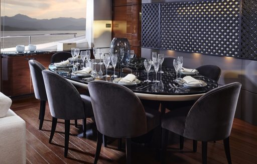 dining area in main salon of superyacht KOHUBA