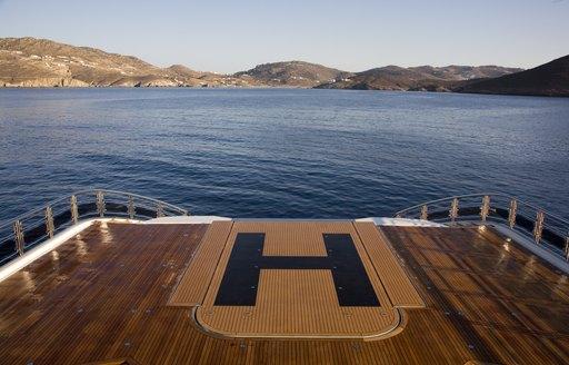 Superyacht Alfa Nero's pool converts into a helipad