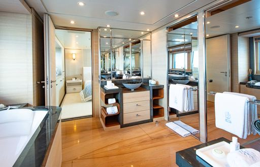 master cabin en suite on luxury yacht spirit with marble tub and mirrored sink