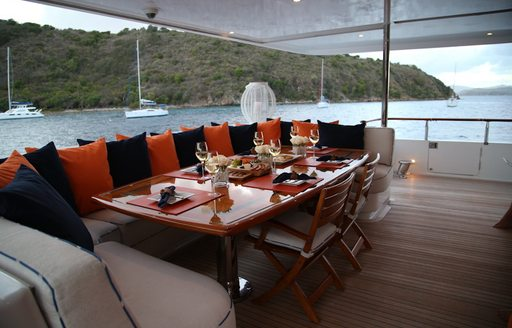 M4 yacht sofa seating area, with cushions and views over the Caribbean