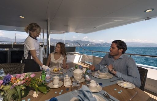 guests on board luxury yacht the wellesley also known as the wellington enjoying an alfresco meal in the morning before they enjoy a day of cruising mallorca