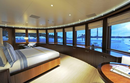 Panoramic windows in master suite in charter yacht TV