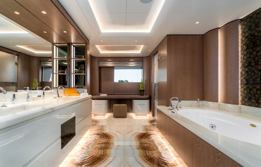 Ensuite on superyacht O'PARI, with bath visible to the right and sink to the left