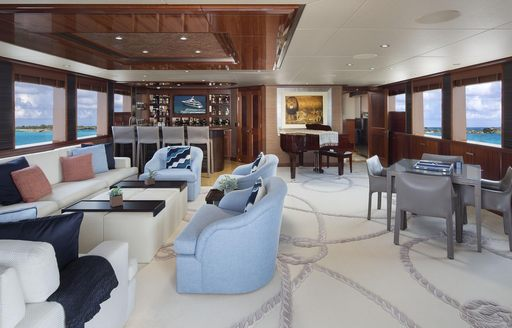 seating area, games table, bar and piano in the skylounge aboard luxury yacht Time For Us