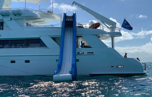 gigantic slide on the side of lucury charter yacht island heiress that slides into the ocean