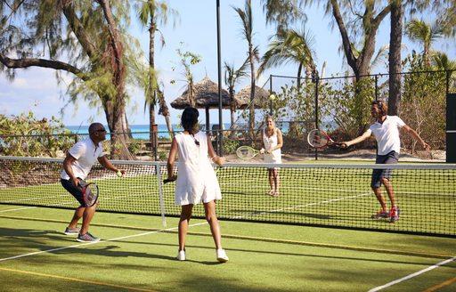 people play tennis on sports court on thanda island