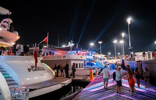 superyachts berthed in Yas Marina at night during the Abu Dhabi Grand Prix