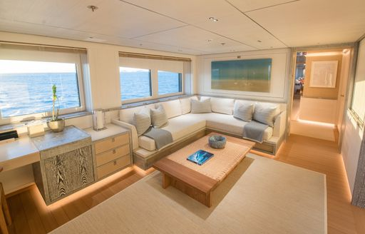 amels charter yacht driftwood clean  and neutral interiors in office area