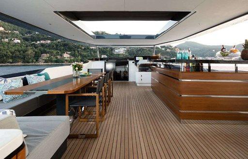 seating area, bar and skylight on superyacht moanna ii
