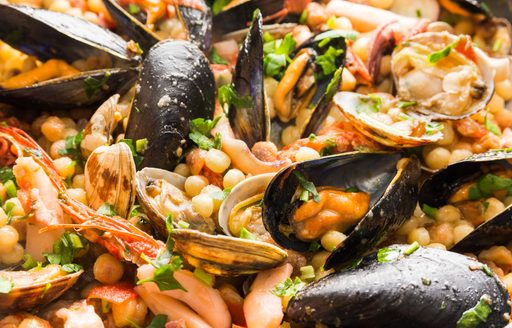 closeup view of a typical Sardinian dish of fregula pasta, mussels and clams