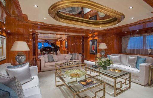 The opulent main salon of luxury yacht Double Down