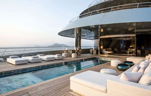 large swimming pool on main deck aft of charter yacht SAVANNAH