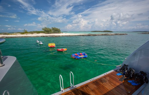 Inflatable toys on board luxury yacht DREAM with views of sandbar in Tahiti