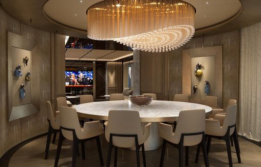 chandelier hanging above the round dining table of superyacht GECO