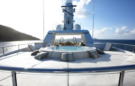 Jacuzzi with sun pads on luxury charter yacht HARLE