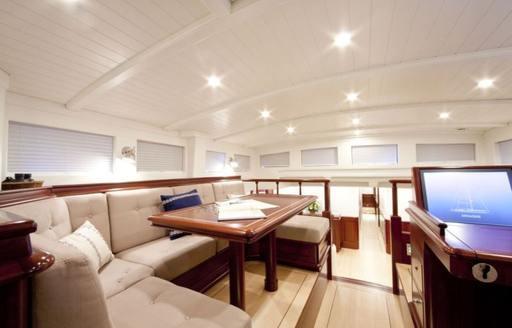 U-shaped sofa seating on luxury yacht Aurelius 111