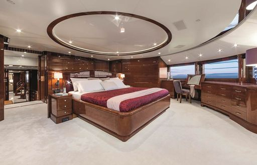 large master suite with 180-degree views on board luxury yacht CHECKMATE