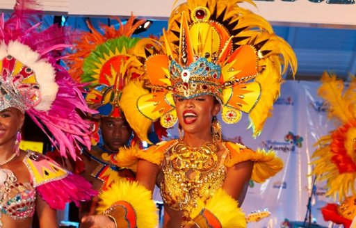 dancer with Vibrant head and shoulder pieces at junkanoo carnival