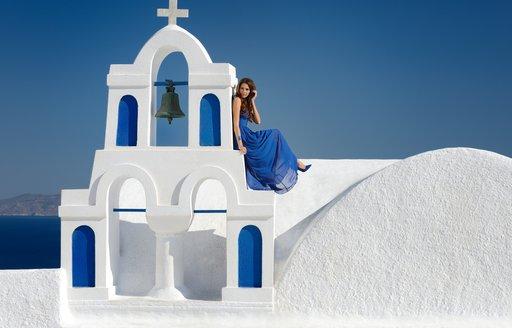 Woman by Santorini building
