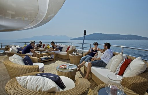O'MEGA's charter guests relax on deck