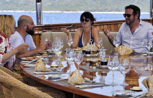 Charter guests enjoy a meal on Christina O