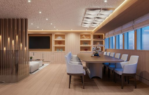 Tables around formal dining table of sailing yacht Love Story