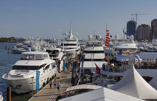 superyachts gathered at palm beach boat show