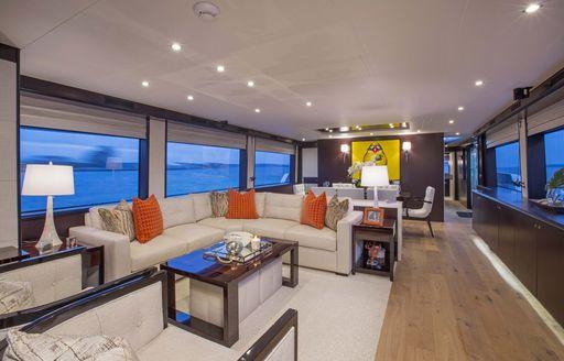 L-shaped sofa in contemporary main salon of charter yacht 'Lady Carmen'