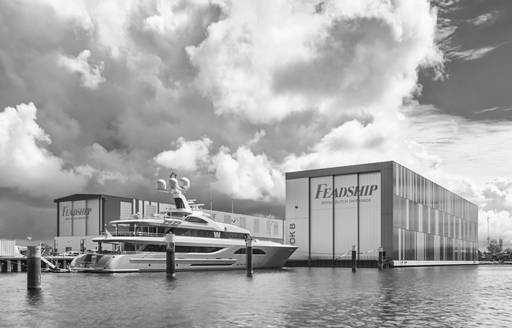 W superyacht outside Feadship shed