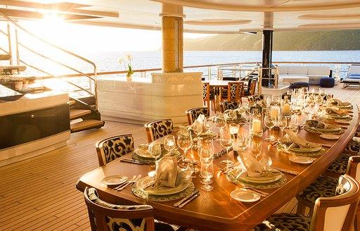 Dining set-up on luxury yacht SOLANDGE