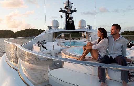 Charter guests on luxury yacht by pool