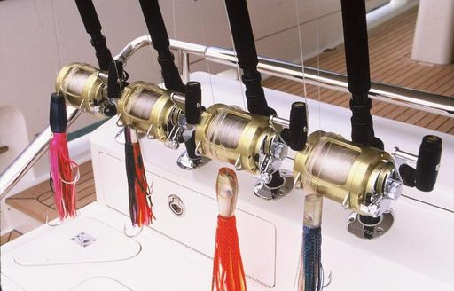 Fishing rods ready on the deck of a luxury yacht