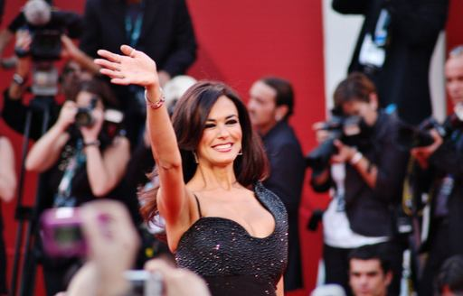 Hollywood starlet faces cameras wearing a black one shoulder diamonte dress at the Venice Film Festival