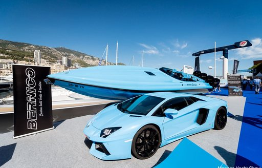 blue prestige car with matching tender at the Monaco Yacht Show 2018