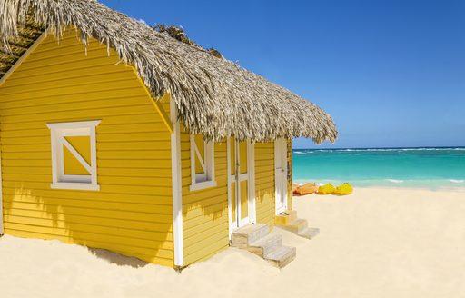 Yellow hut on beach in Bahamas