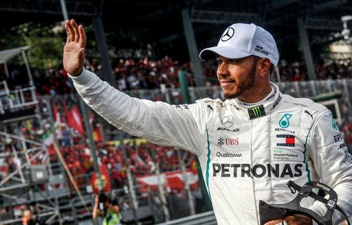 F1 driver Lewis Hamilton waves at crowds after F1 win