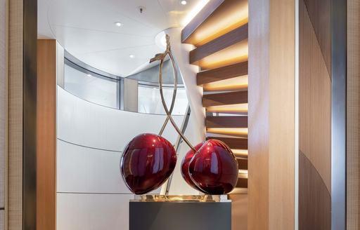 cherry statues on luxury yacht lunasea