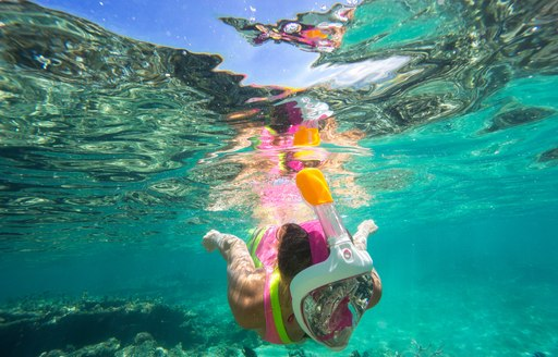 Girl snorkelling in the clear waters of Antigua, the Caribbean