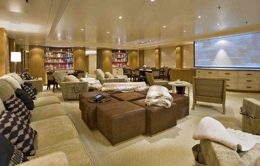 The brown and bronzed furnishings inside of a superyacht