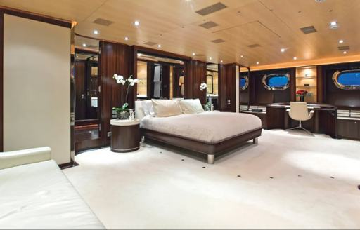 Master cabin onboard Parsifal III, central berth overlooks spacious cabin with vanity desk in background