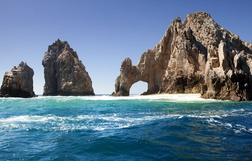 Striking rocks and small sandy islet in Sea of Cortez, Mexico