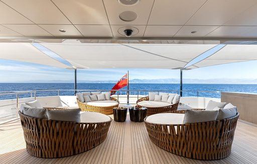 chairs on the exterior deck of luxury yacht la datcha
