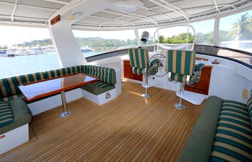seating and table on flybridge of luxury yacht BAHAMA