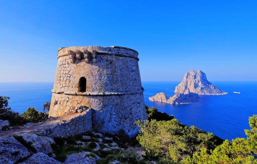 Turret in the mountains in Spanish island of Ibiza, looking out over Es Vedra rock
