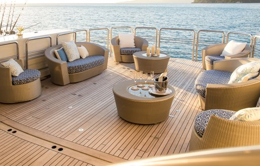 Seating arrangement set up on aft swim platform of luxury catamaran SPIRT